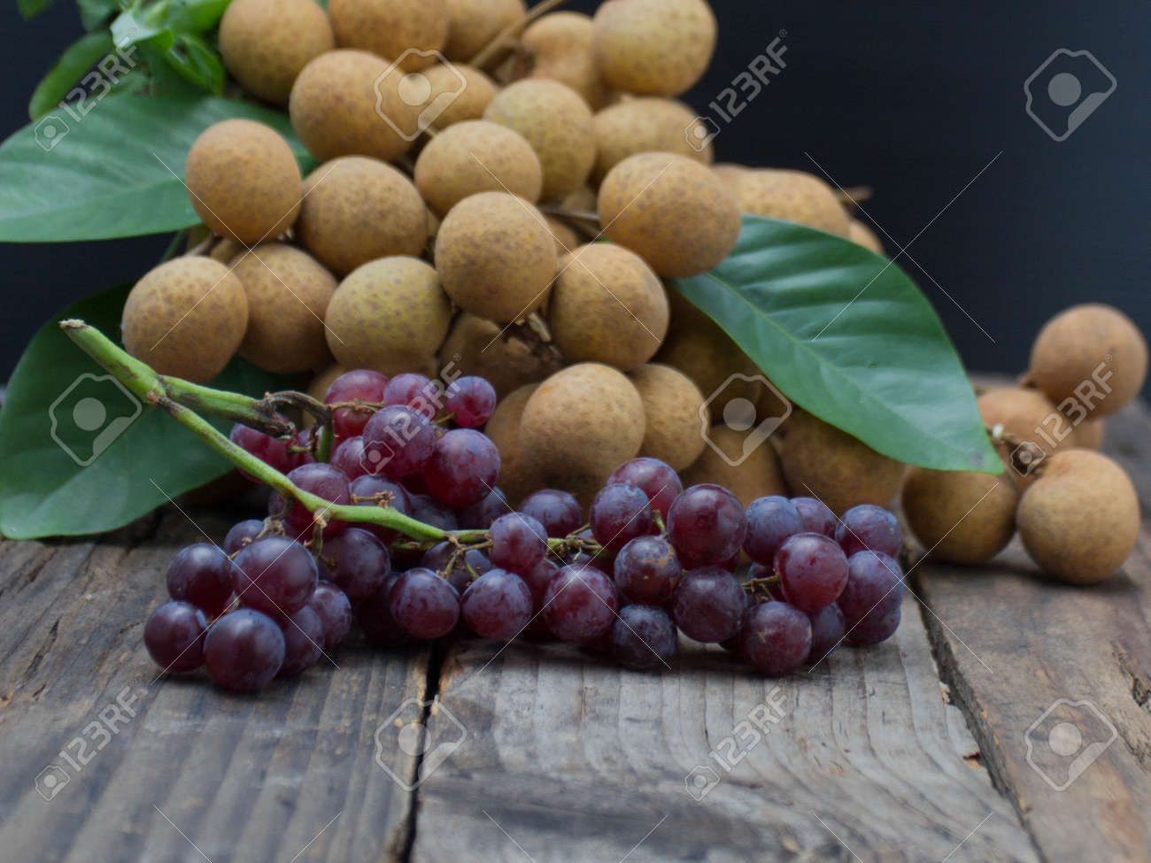Lots of longan fruit on the wooden table. - 153222424