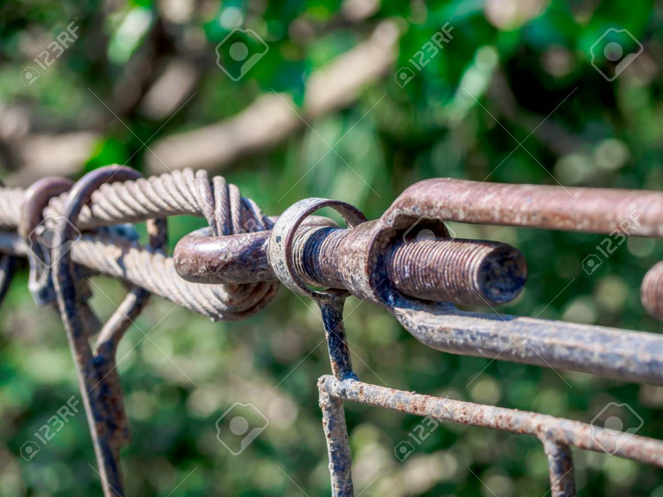 Rusty sling hook and knots close, bolts used to mount the bridge