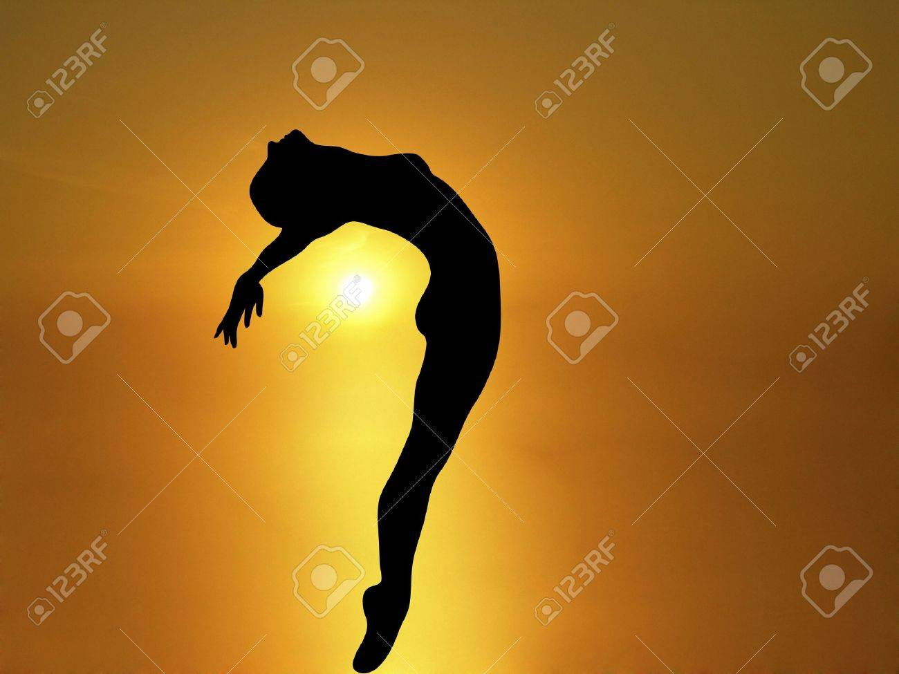 silhouette of woman dancing with brilliant sunset background Stock Photo - 1954622