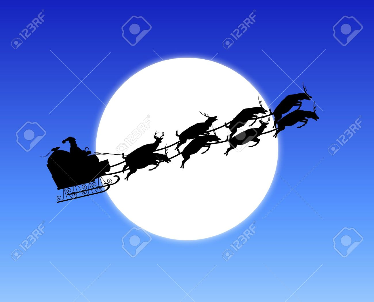 silhouette of santa u0027s sleigh across moon stock photo picture and