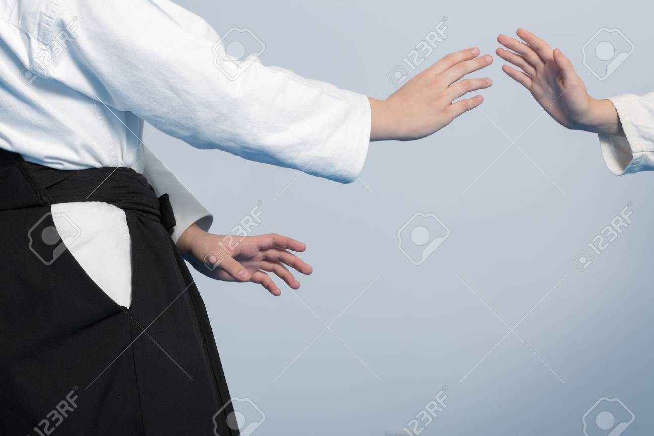 Hands of two girls standing in a stance on martial arts training - 49715454