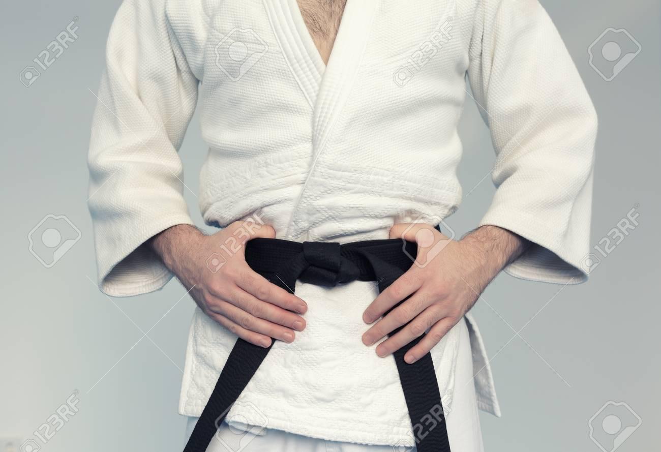 Martial arts Master with black belt in white kimono - 55408280