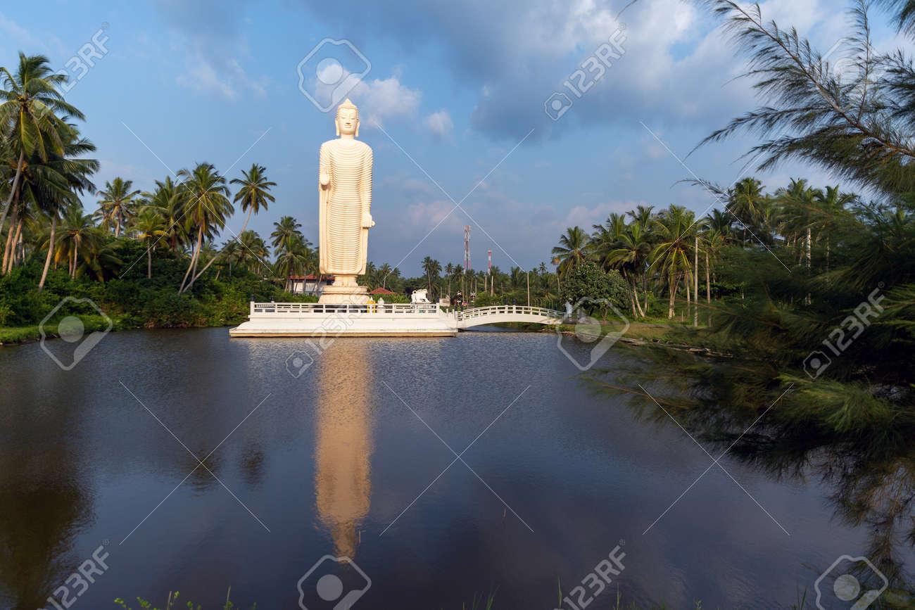 Buddha Statue - Tsunami Memorial in Peraliya, Sri Lanka - 164040417