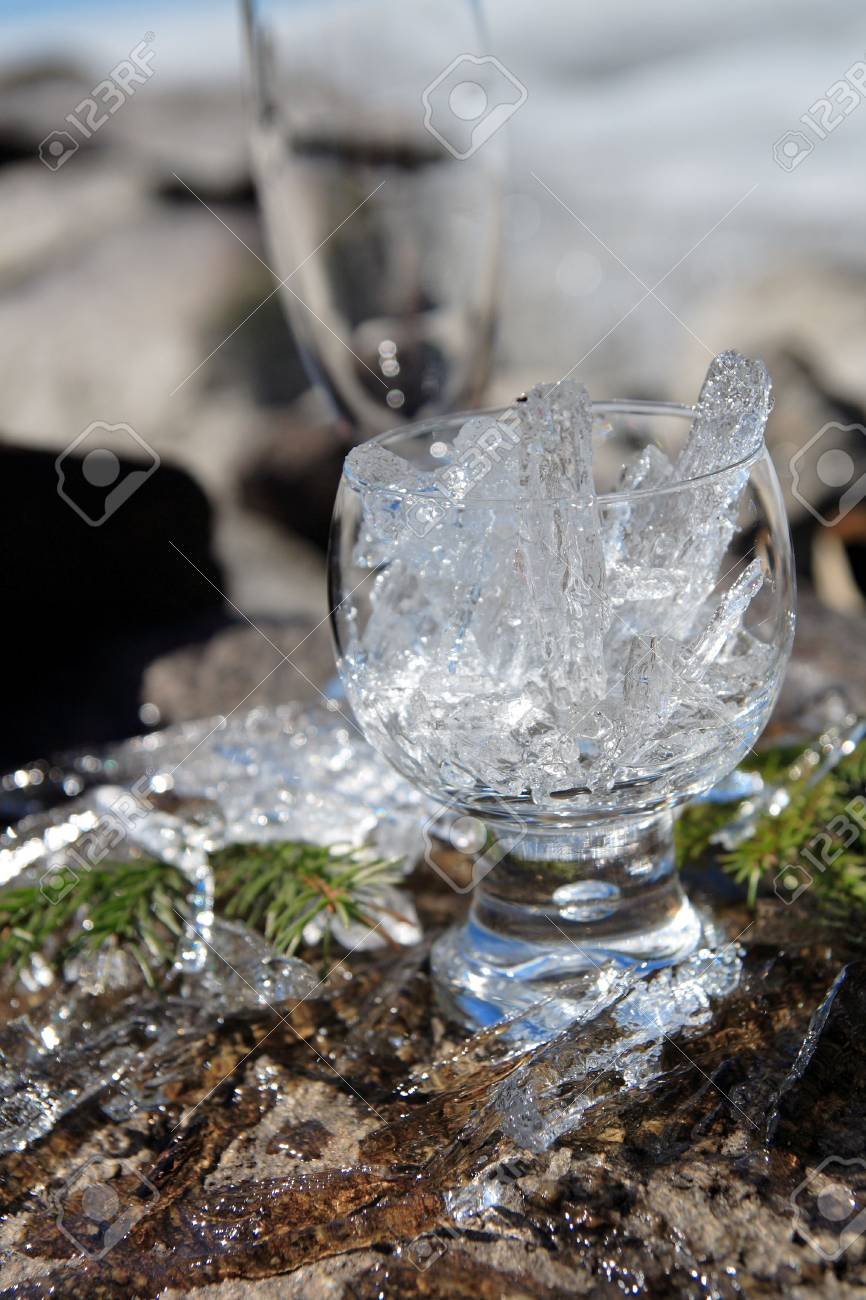 Glasses with ice on the edge of a frozen lake Stock Photo - 3150068
