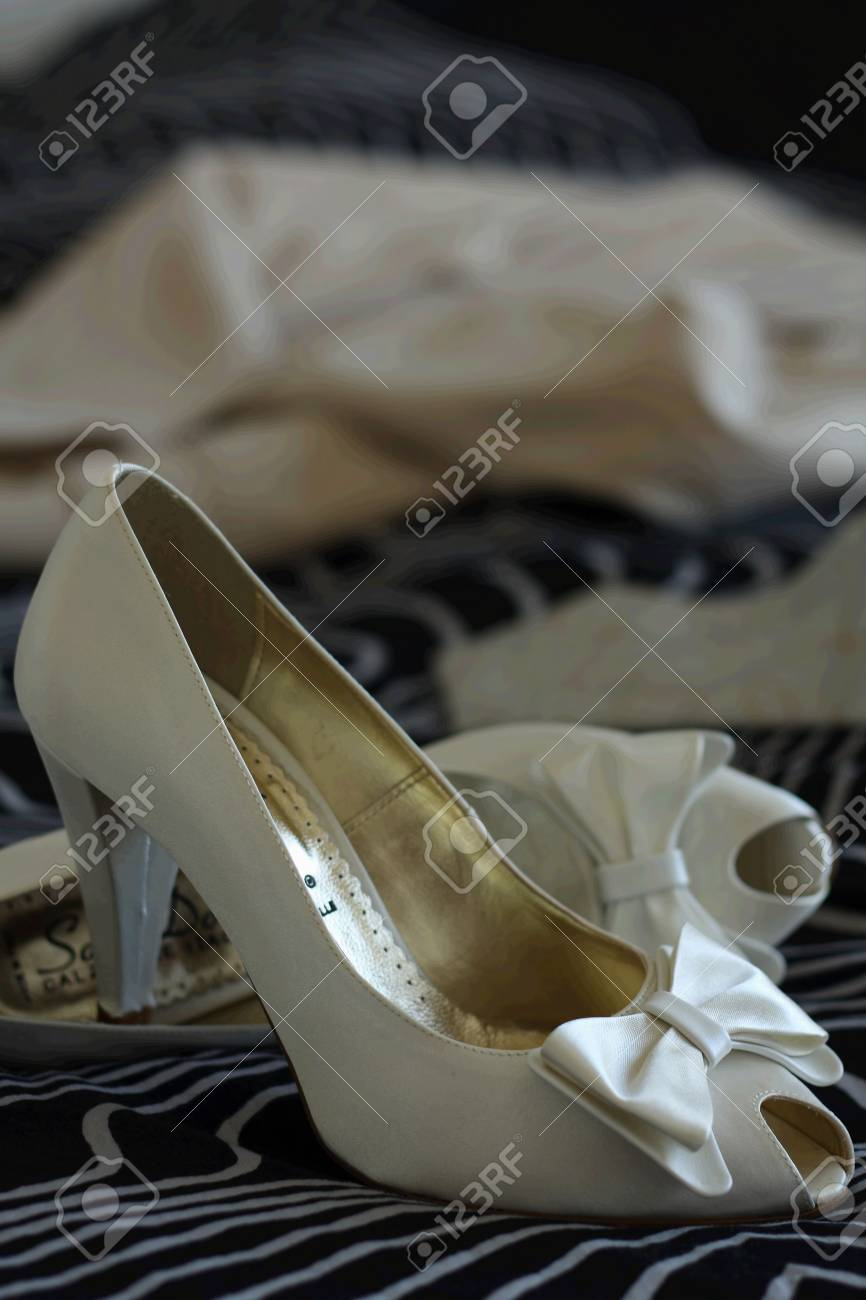 Wedding shoes and dress before  the wedding Stock Photo - 3338449