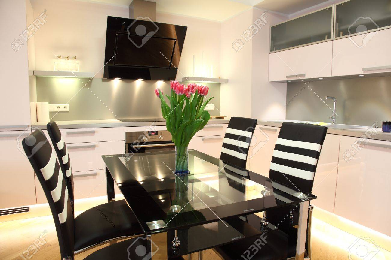 Beautiful modern nordic kitchen with modern lighting and fresh flowers Stock Photo - 13056973