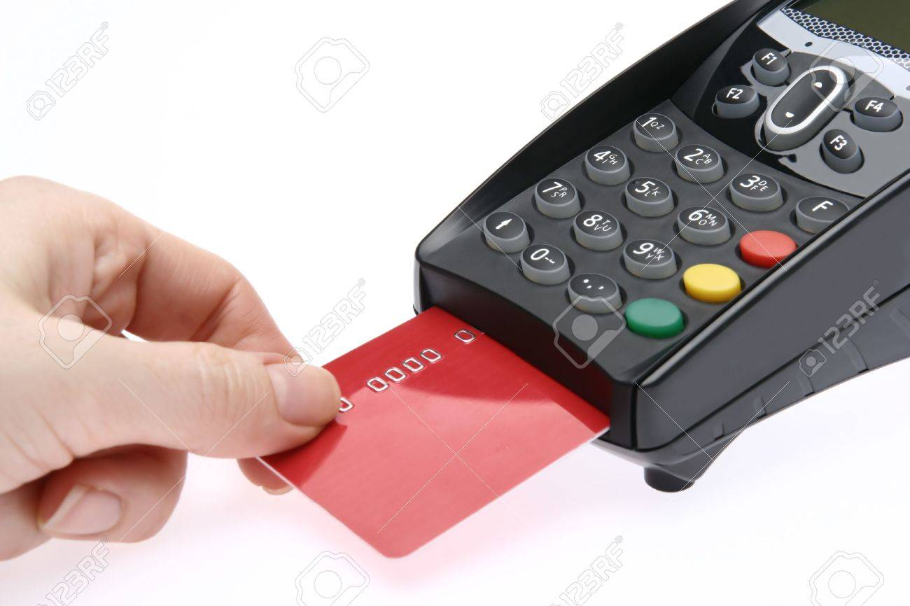 Swiping of the credit card for payment processing. Stock Photo - 5602212