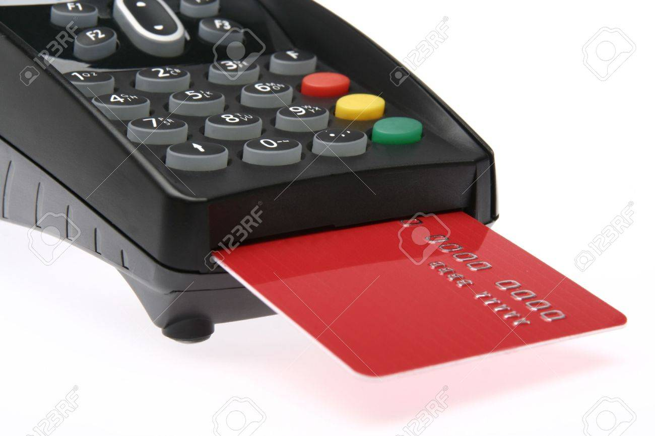 Swiping of the credit card for payment processing. Stock Photo - 5602206