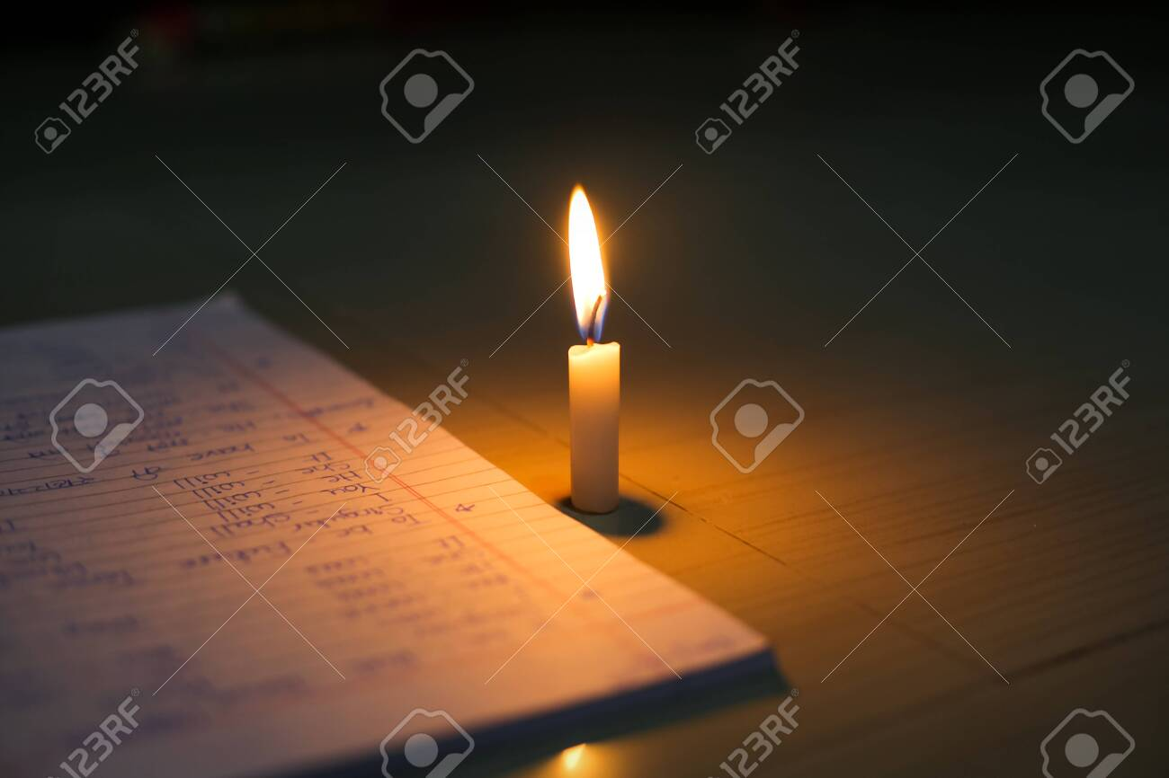 Candle near books. hope for education alive with the light of candle - 144312024