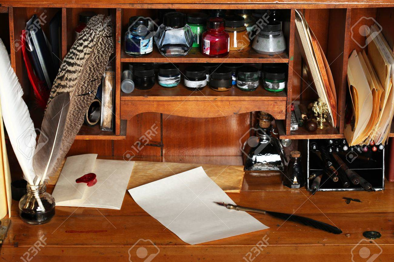 Old writing desk full of quills & inks for calligraphy Stock Photo - 7447674
