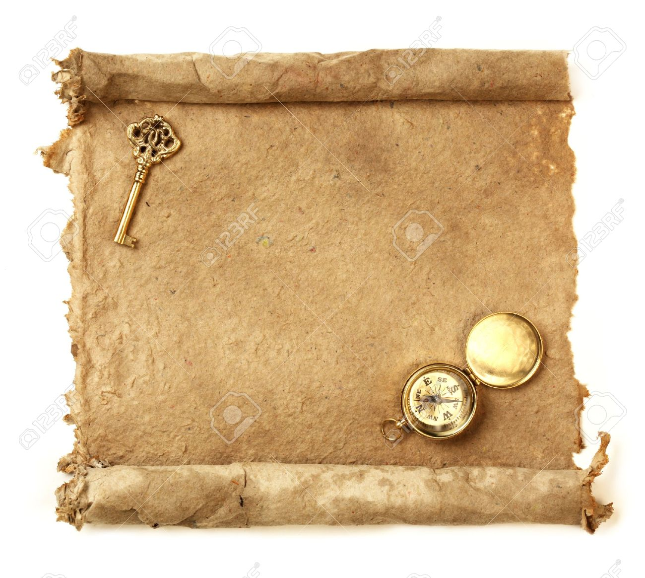 Handmade paper scroll with key and a compass Stock Photo - 9343668