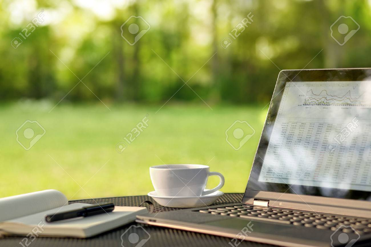 Laptop And Coffee In Outdoor Office Stock Photo   39344590