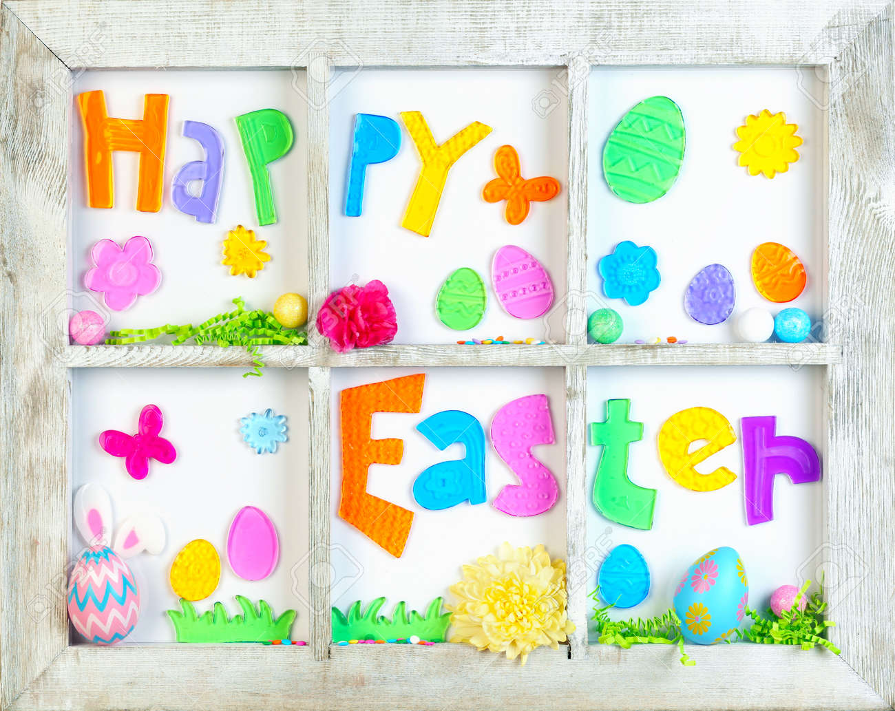 Happy Easter decorations in old wooden window - 165169597