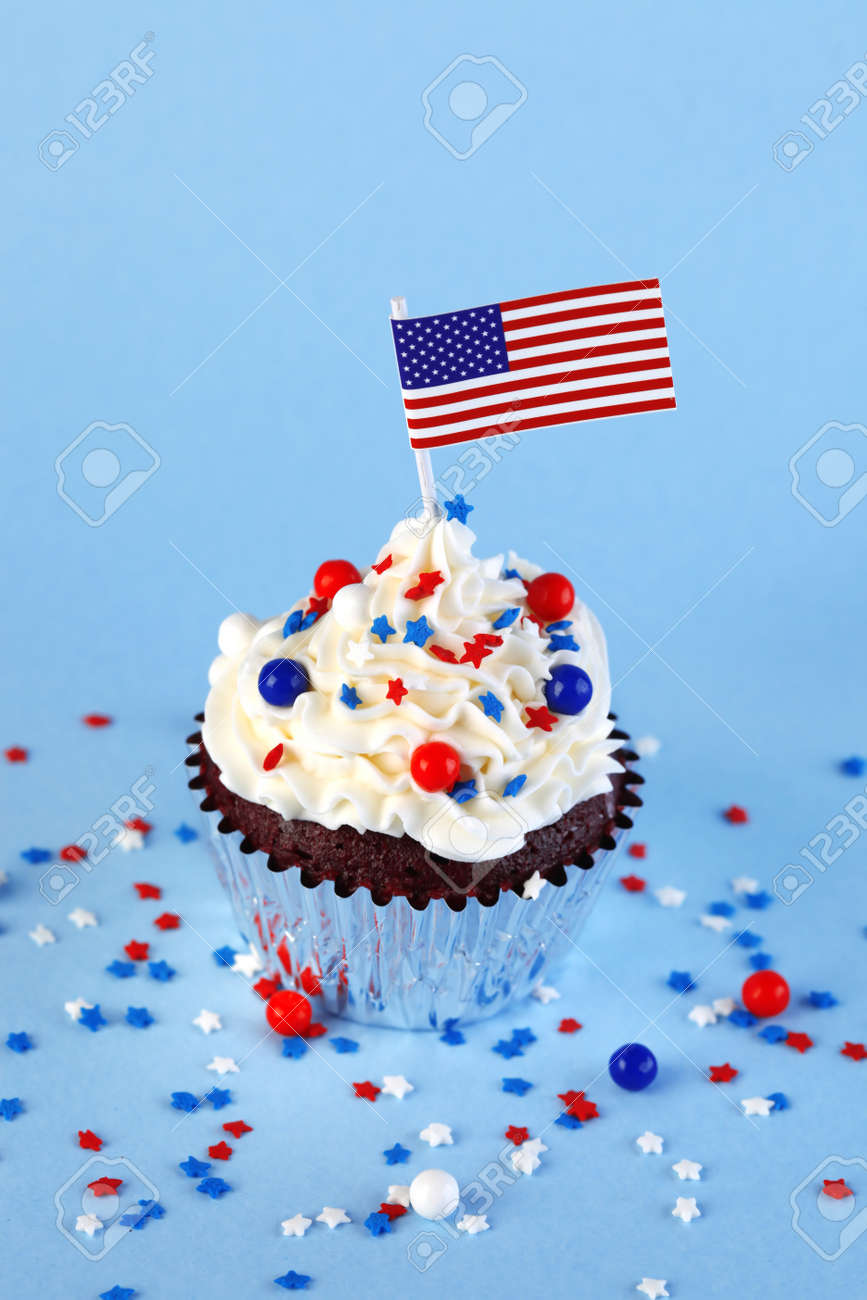 4th of July cupcake with flag and sprinkles - 170507237