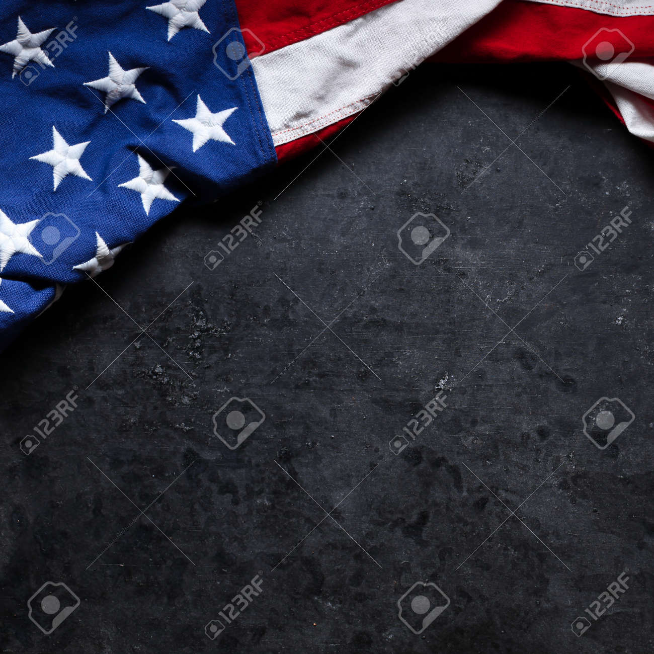 US American flag on worn black background. For USA Memorial day, Veteran's day, Labor day, or 4th of July celebration. With blank space for text. - 170507300