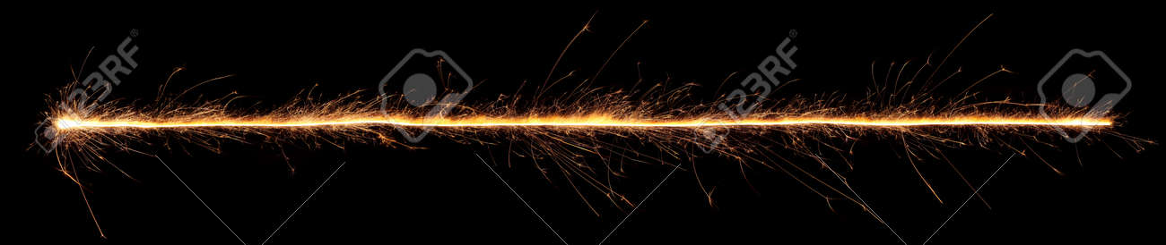 Sparkler trail of light with sparks in a straight line. - 170989054