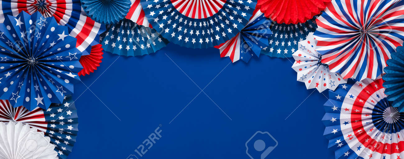 Vibrant red white and blue paper fans with copy space for text. For 4th of July, Memorial day, Veteran's day, or other patriotic holiday celebrations. - 170989055