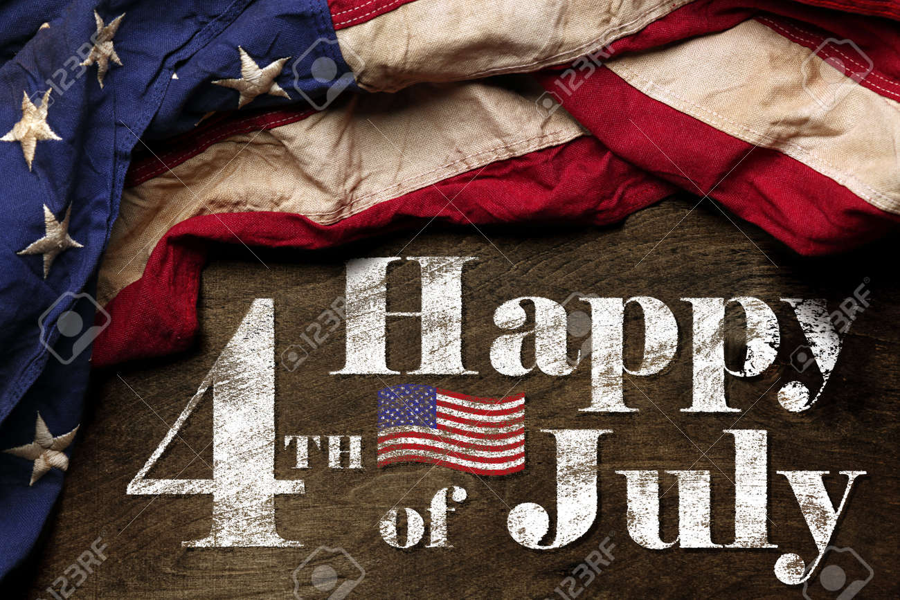 Happy fourth of July text with red, white, and blue American Flag - 170989058