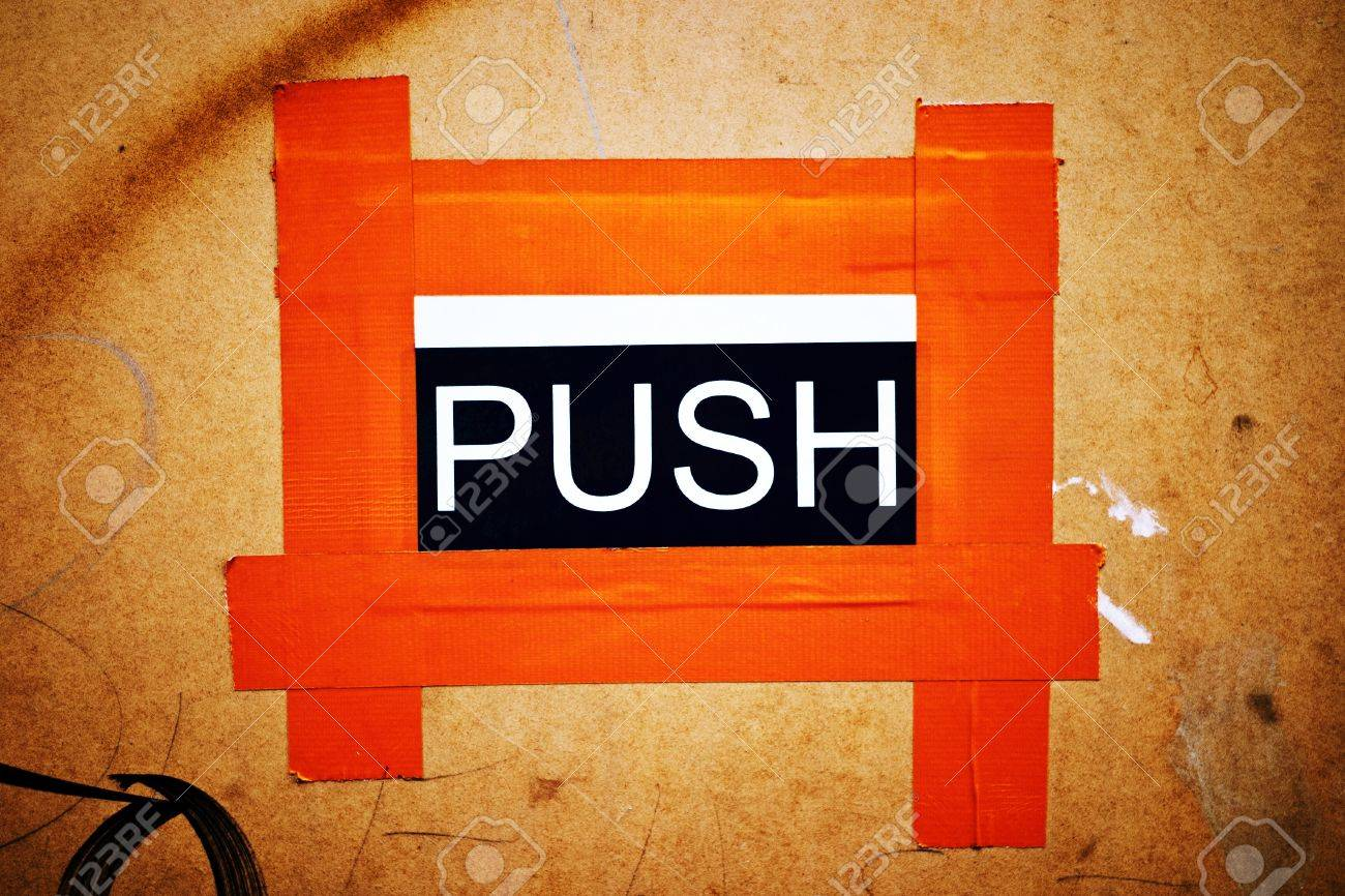 A makeshift PUSH door sign stuck to a chip board door with orange gaffer tape Stock & A Makeshift PUSH Door Sign Stuck To A Chip Board Door With Orange ...