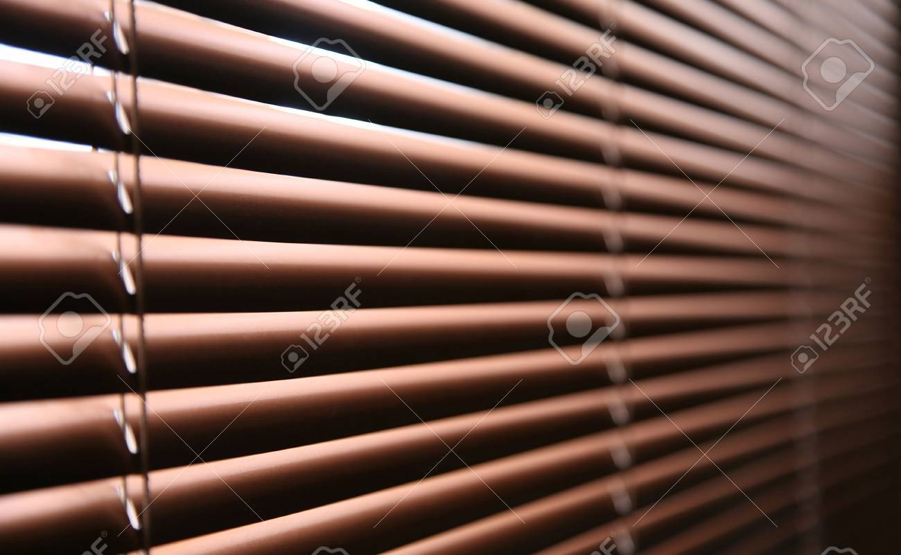 Sun-protection jalousie of brown color in a bright sunny day Stock Photo - 4548009