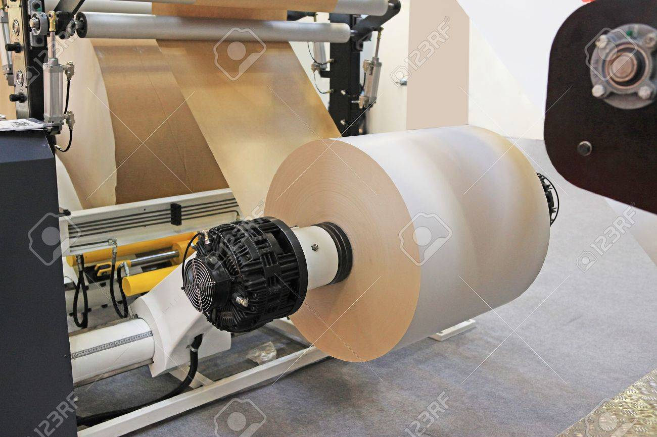 offset print machine for newspaper production from big rolls of paper. Stock Photo - 11078723