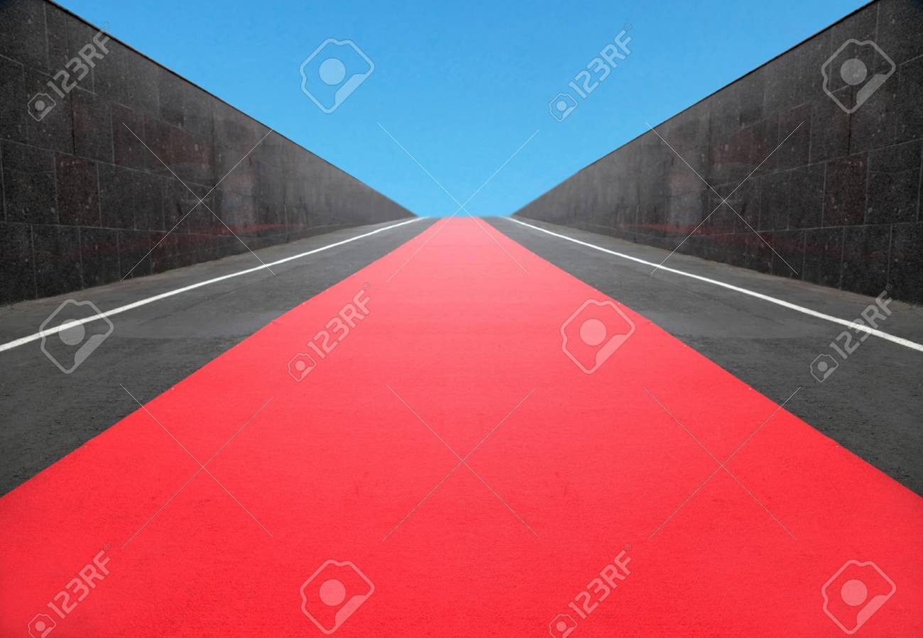 the red carpet among granite walls conducts to the dark blue sky Stock Photo - 16031162