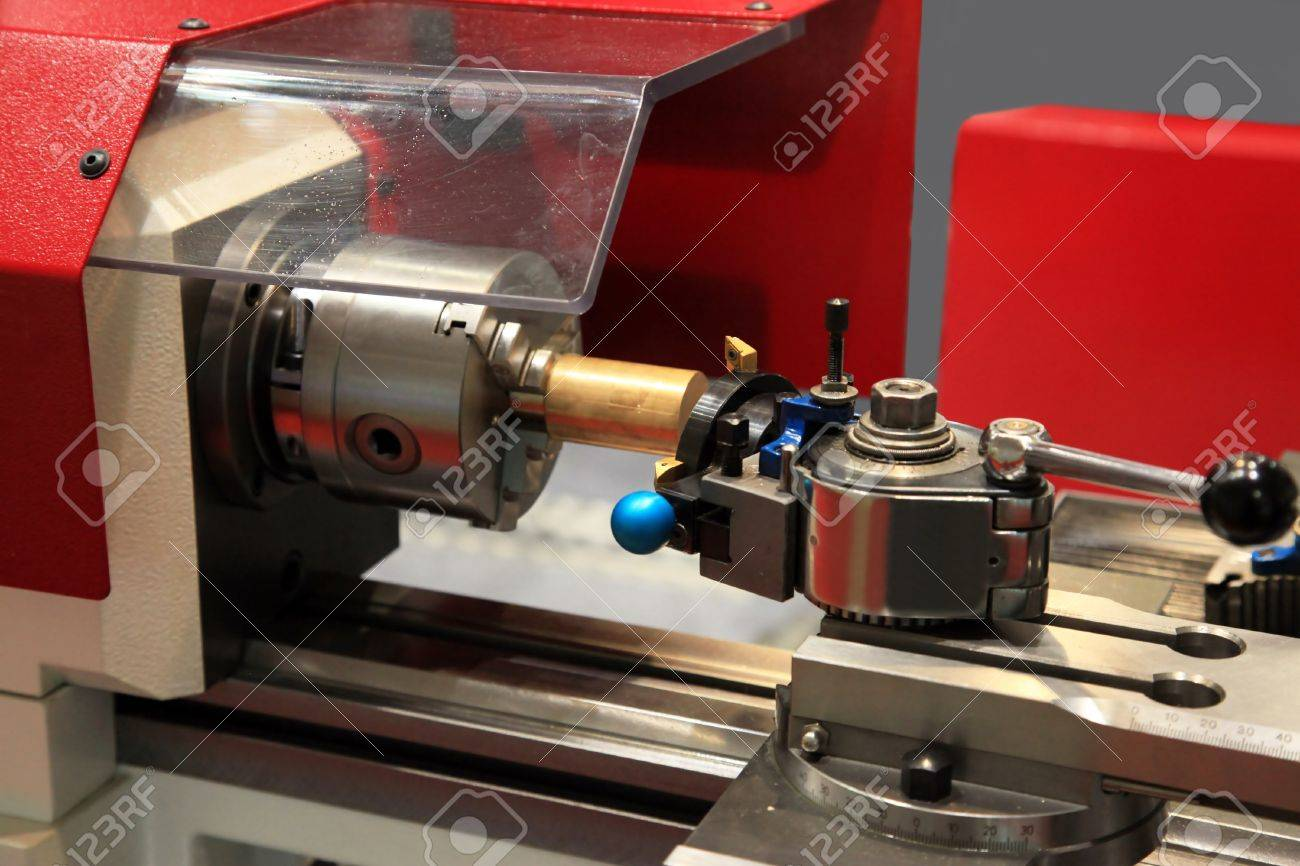 Small portable metal lathe with tool and workpiece