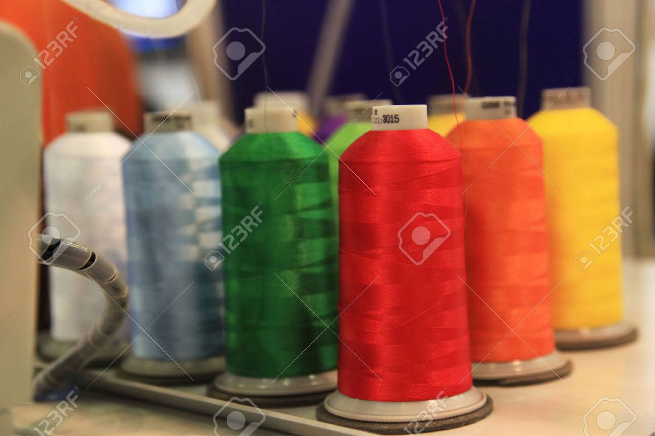 Spools of thread at a textile knitting machine - 54566114