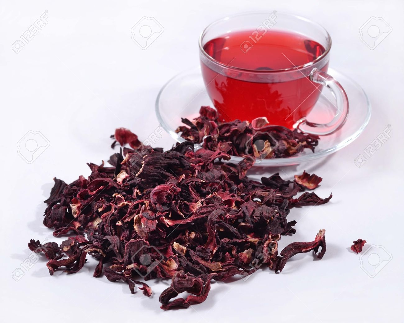 Cup Of Hibiscus Tea And A Heap Of Dried Petals Of Hibiscus Stock