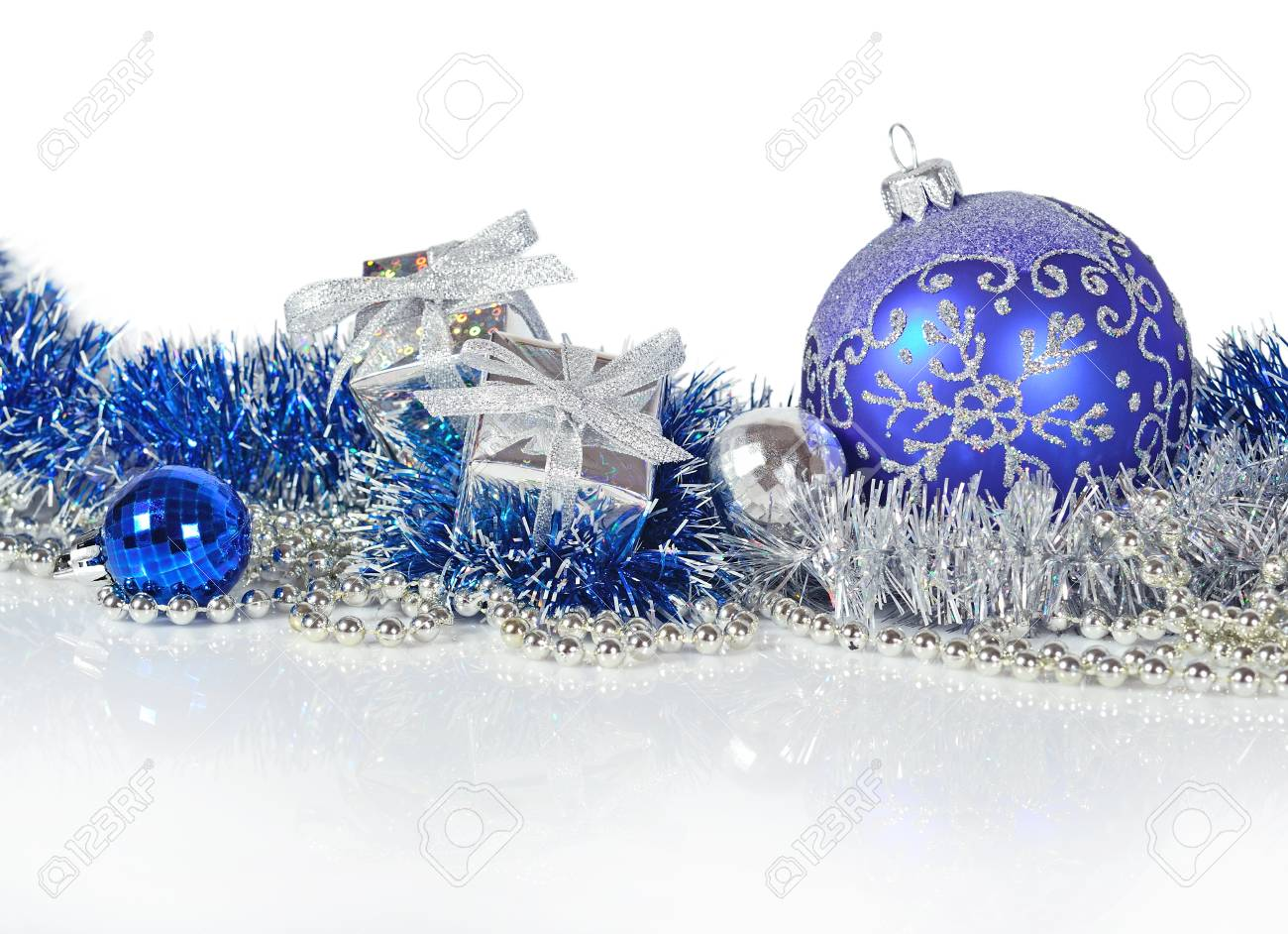 Blue and silver christmas decorations on a white background stock