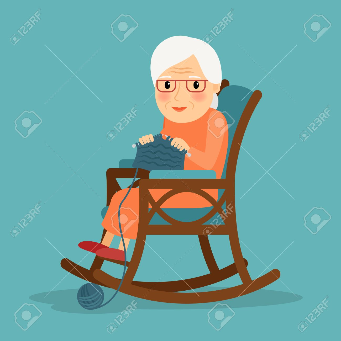 Knitting. Old woman knits. Granny knitting in her rocking chair. - 55978013