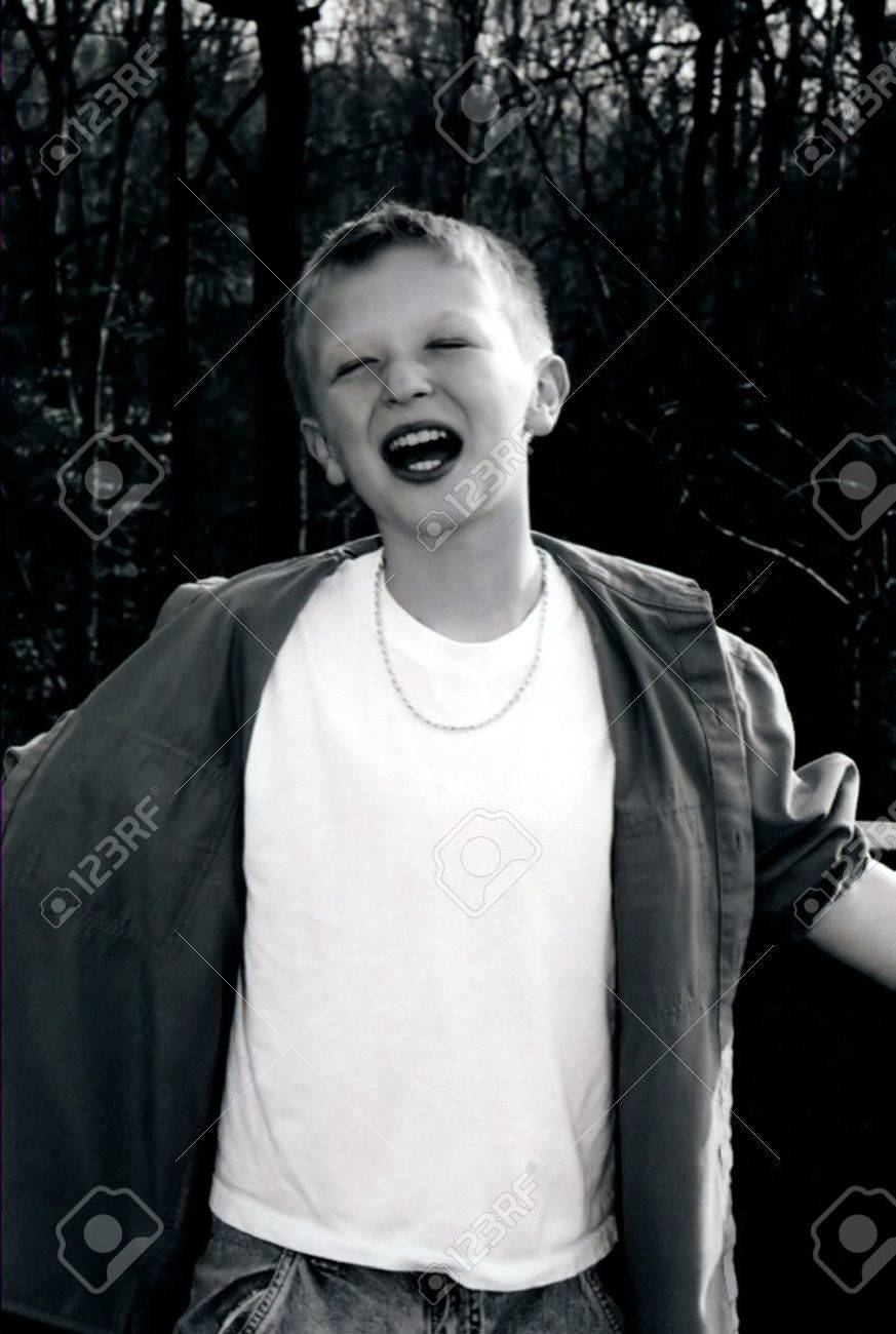 black preteen Black and white portrait of preteen boy with arms spread open. Stock Photo - 357590
