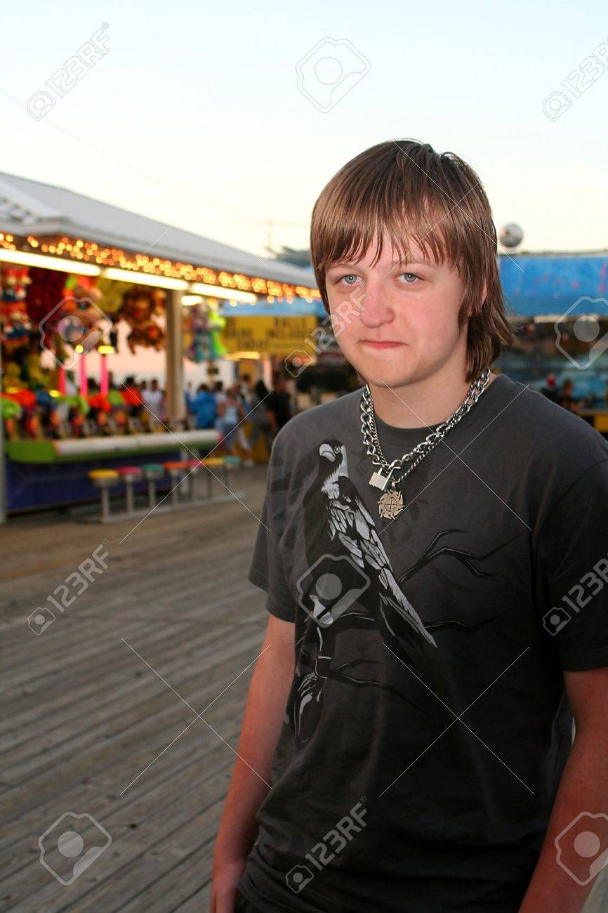 Sad Teen On Festive Boardwalk Stock Photo - 11377867