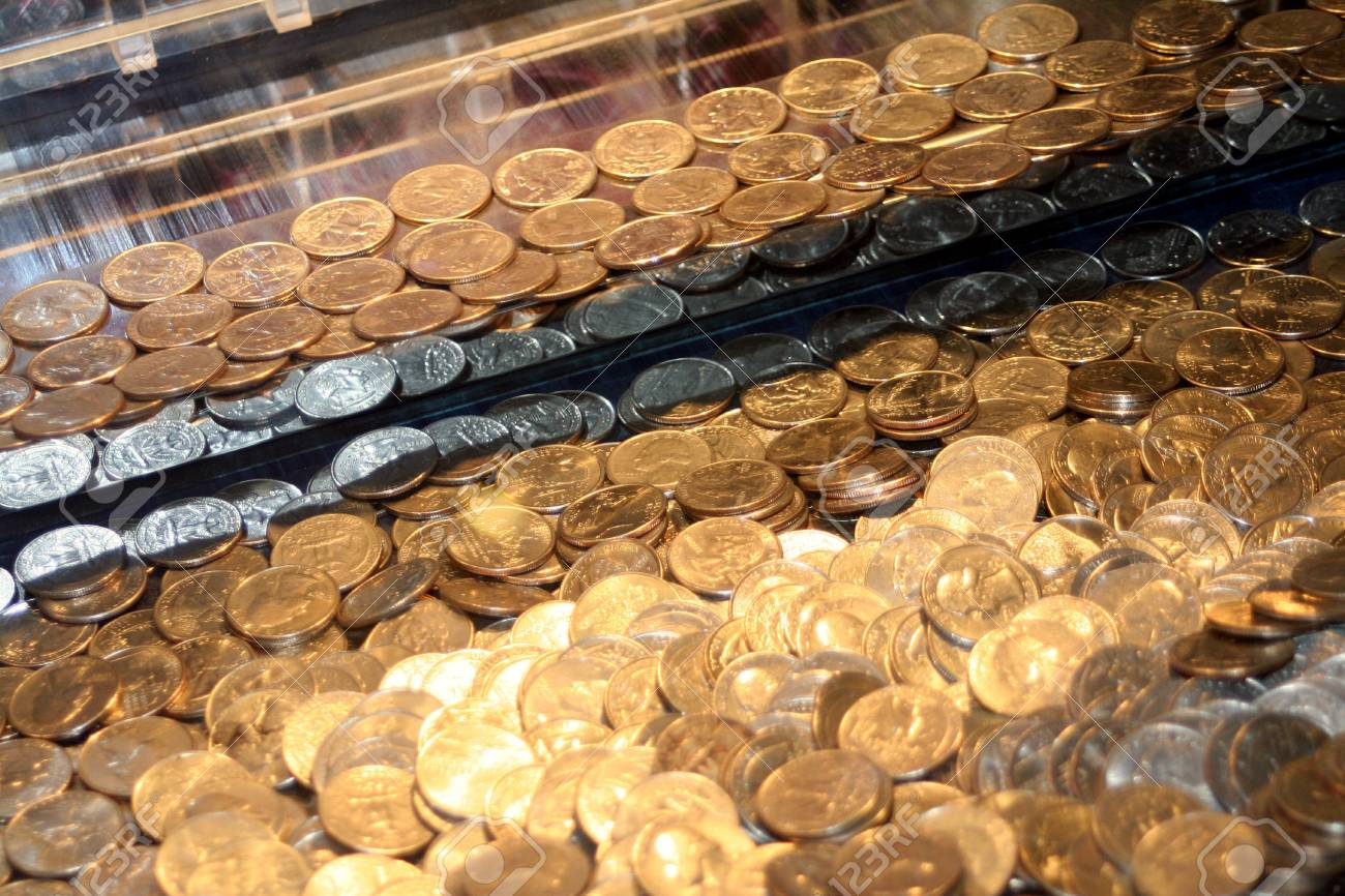 Quarters In An Arcade Game Stock Photo - 12467399