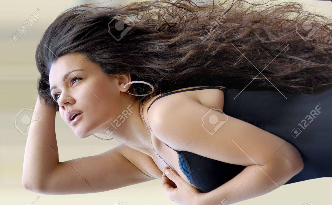 pretty girl with great dark fly-away hair stock photo, picture and