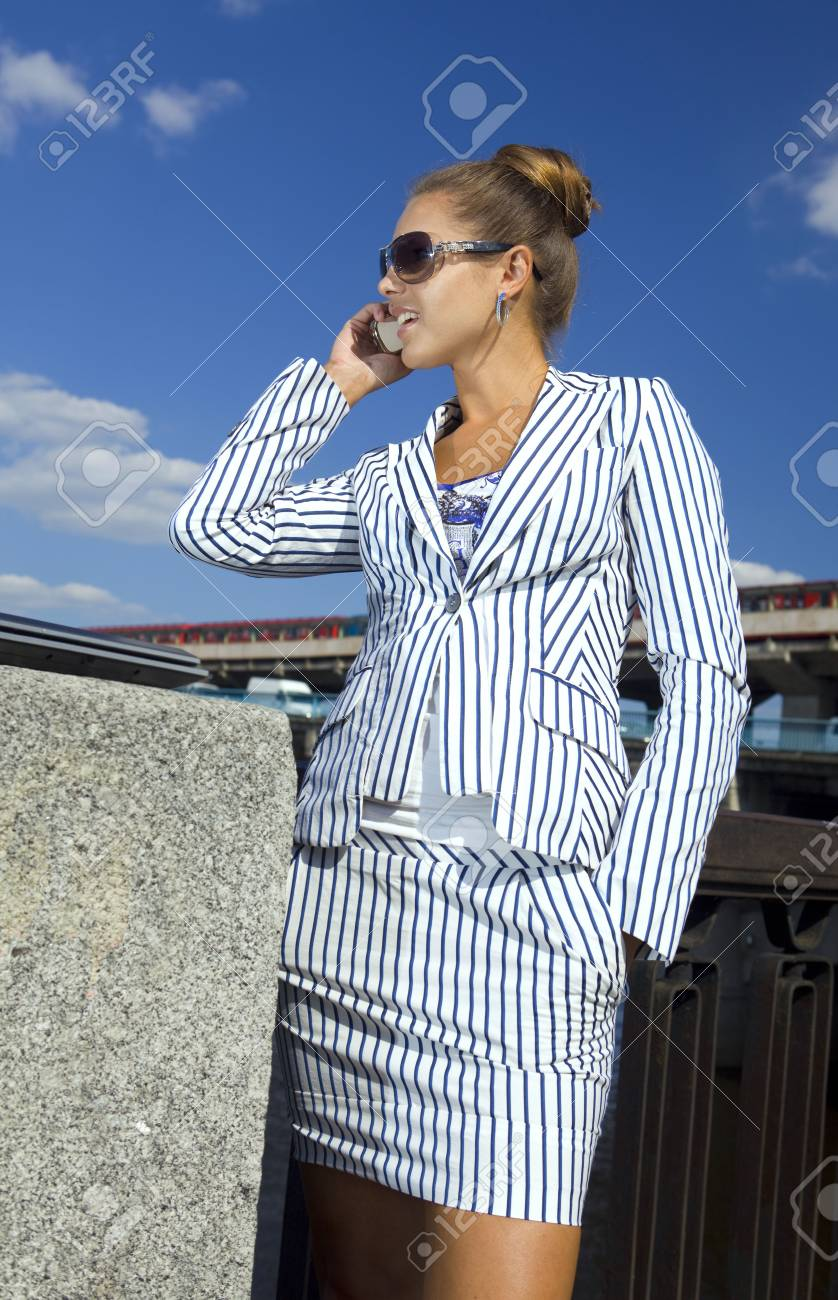 happy young woman speaks by mobile phone on the street Stock Photo - 7501026