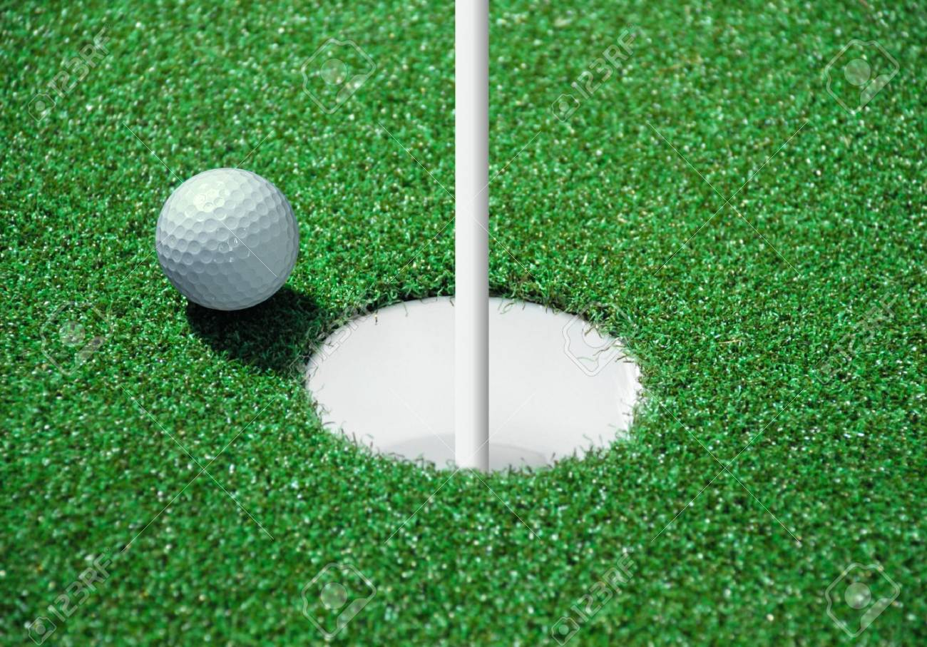 golf ball on lip of cup of lovely tropical golf course Stock Photo - 7561147