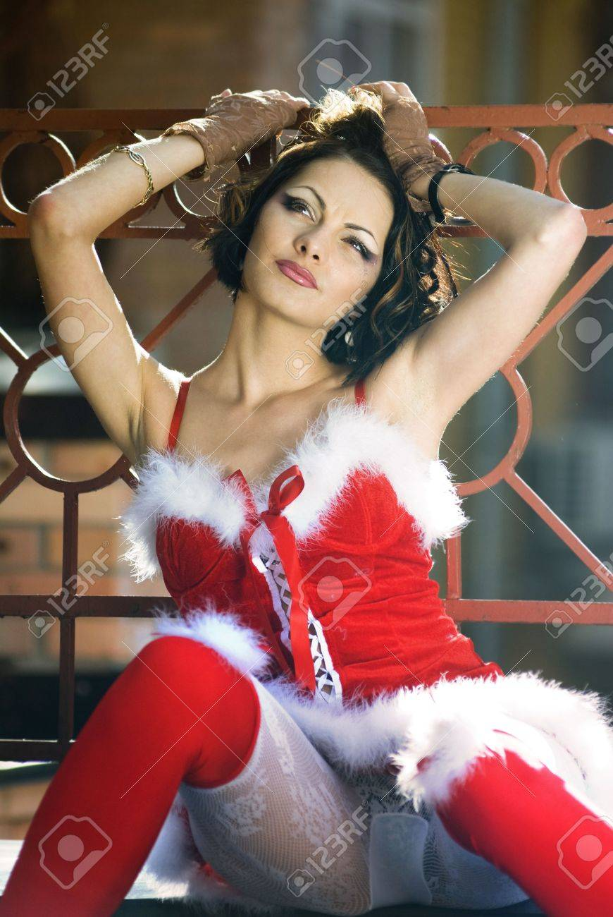 beautiful happy sexy girl wearing santa claus clothes on city background Standard-Bild - 7642333