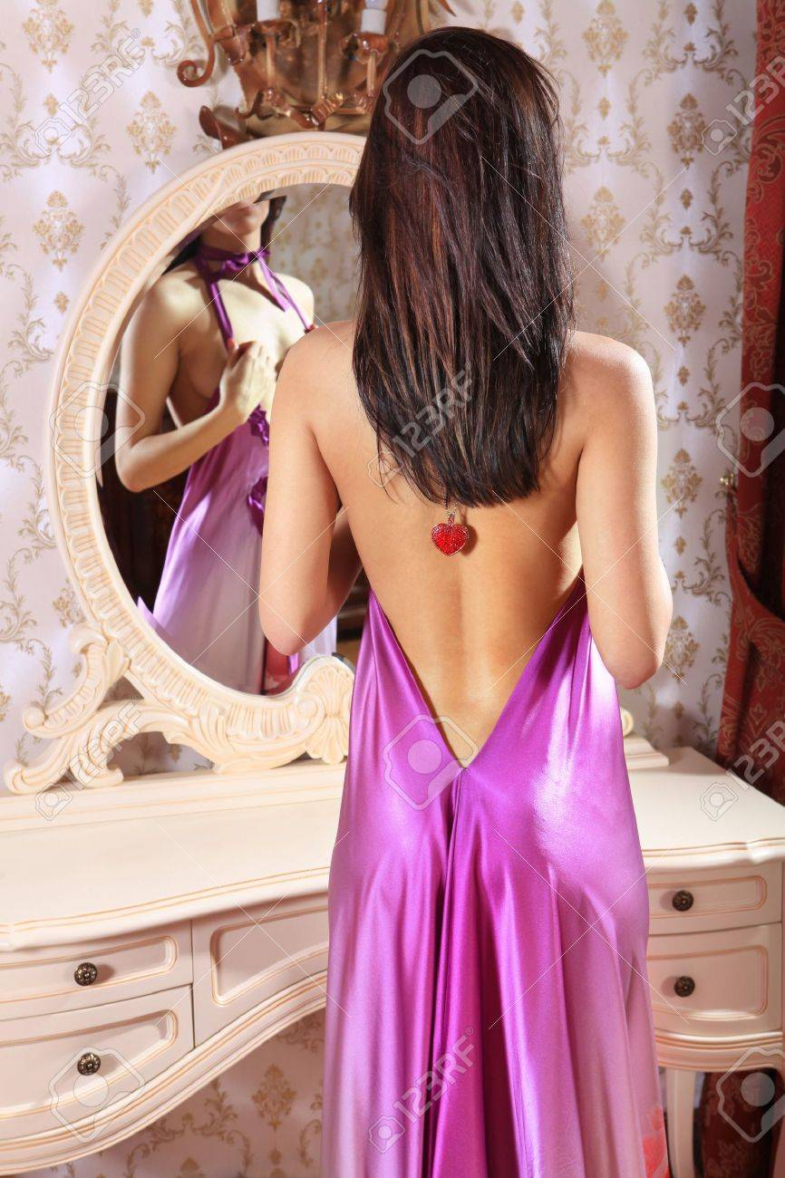 back of beautiful woman in front of mirror in dressing room Stock Photo - 8539033