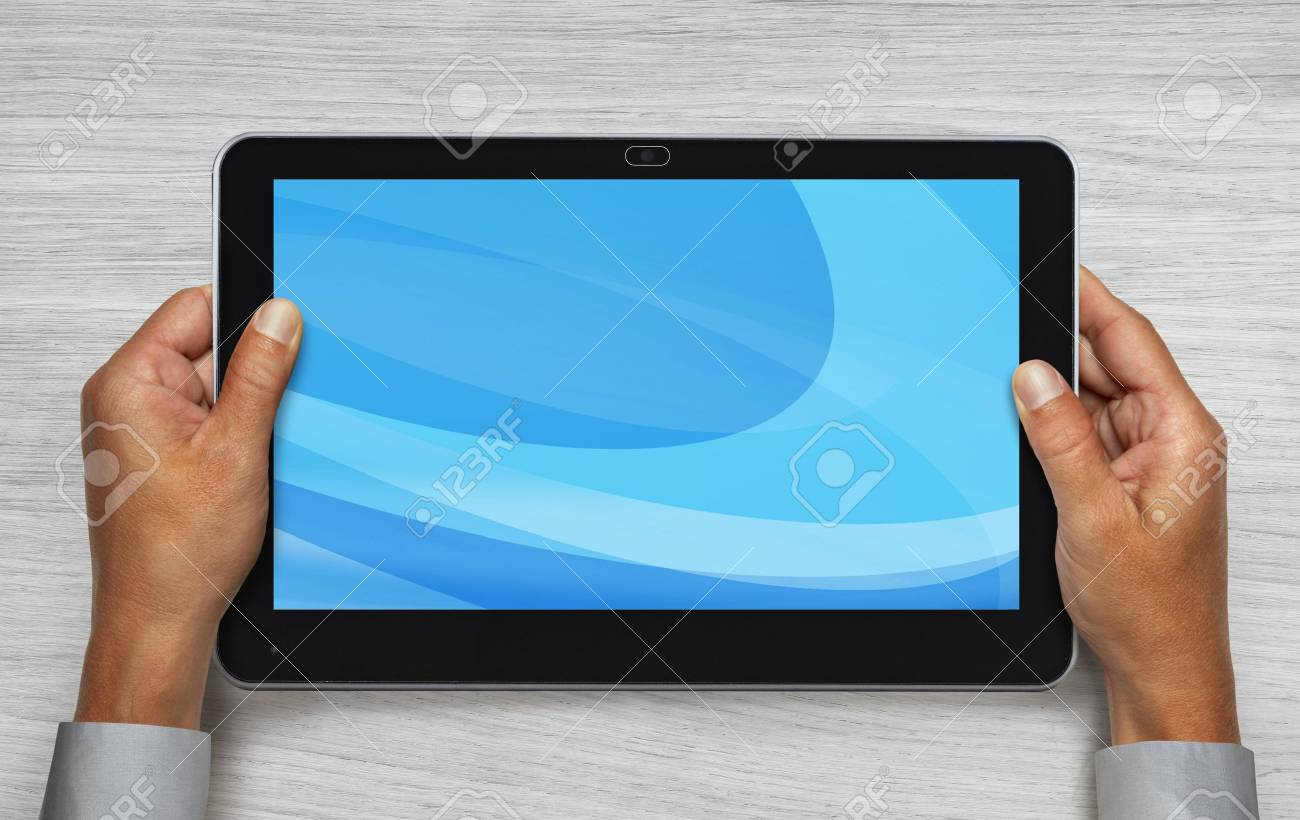 hands of businessman holding touchpad pc under table Stock Photo - 9653836