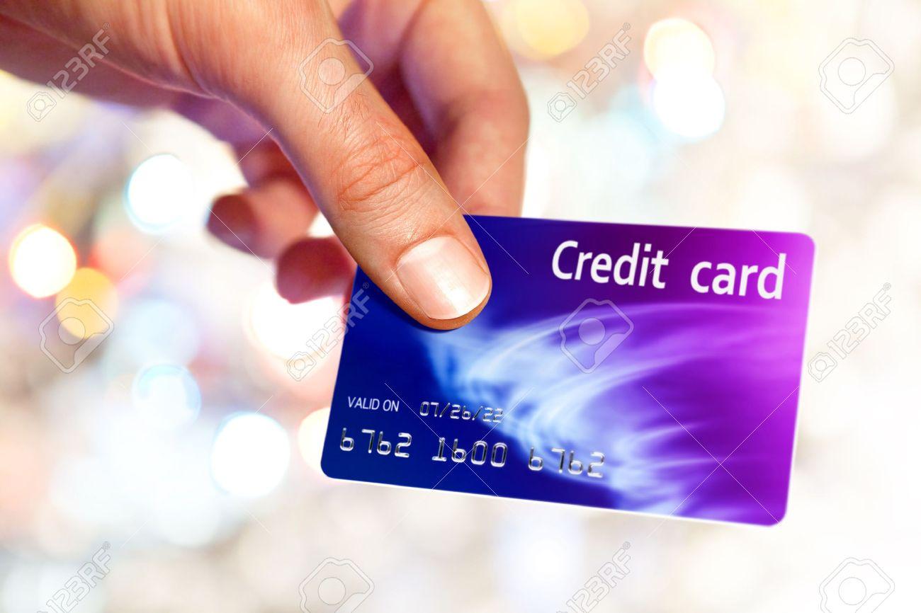 Close-up of man hand holding plastik credit card Stock Photo - 12156972