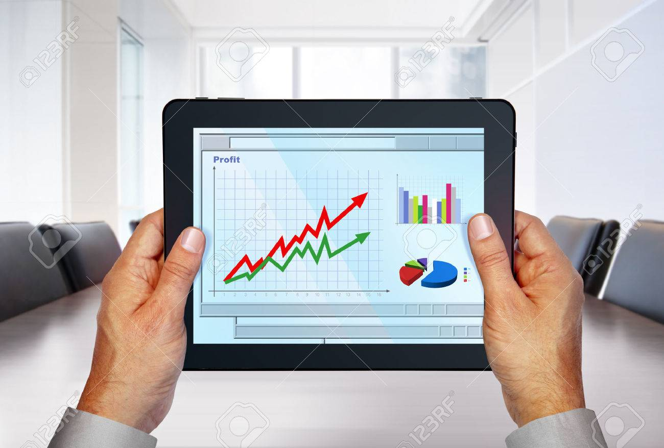 touch pad with computer graphics on screen in hands Stock Photo - 24909745