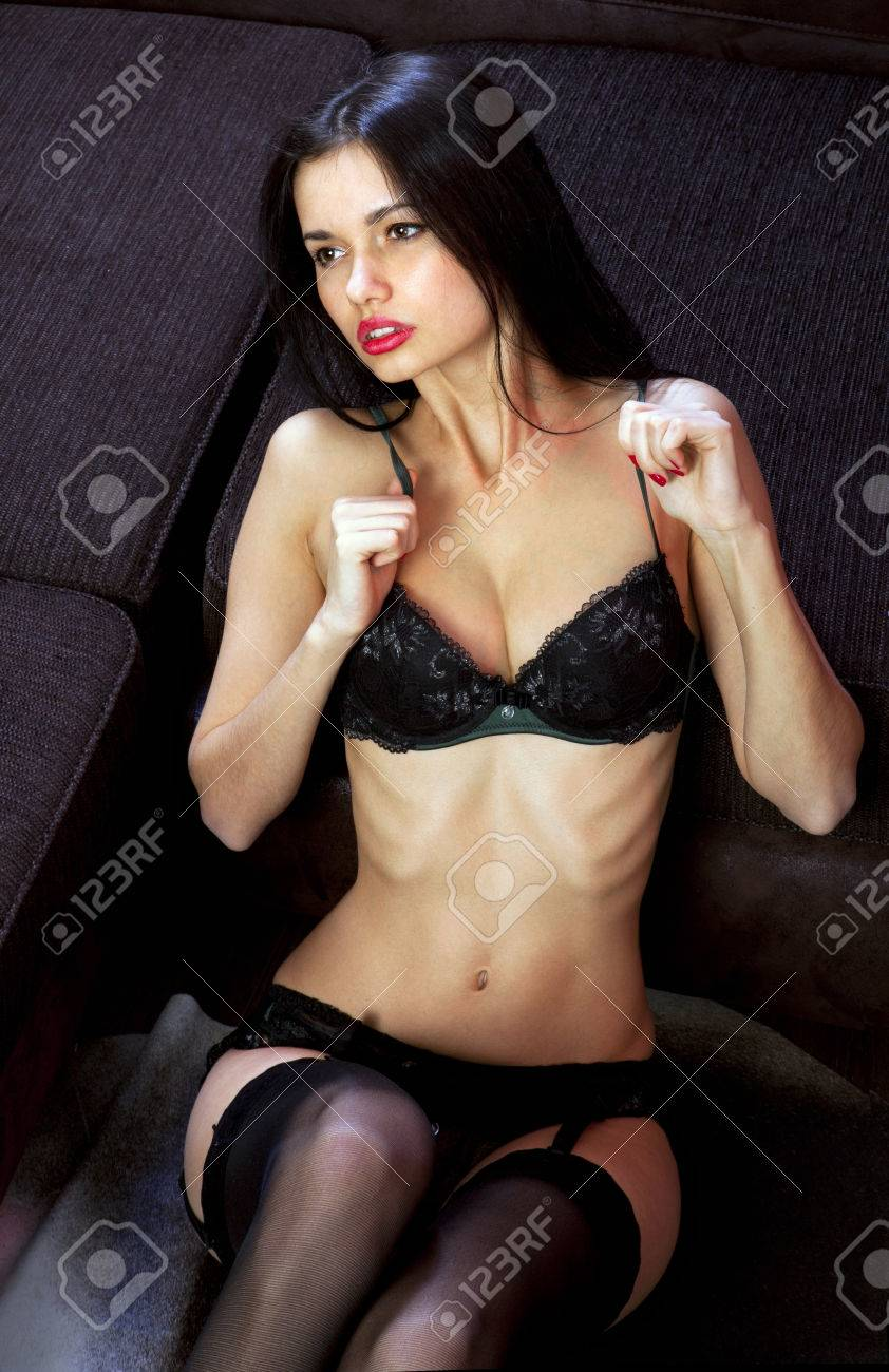 fa8af65d193 voluptuous sexy girl in black underwear derives pleasure on sofa Stock  Photo - 75166553