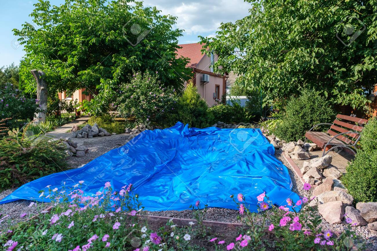 Rolled Out Blue Hdpe Plastic Sheet On The Ground To Set Up A Stock Photo Picture And Royalty Free Image Image 153797538