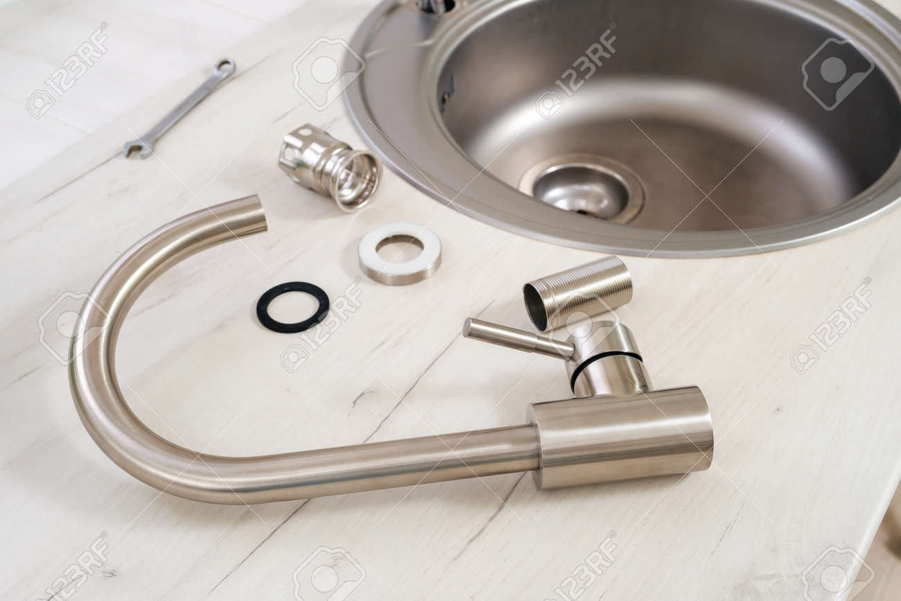 Closeup New Faucet And Tools For Installing Into The Kitchen Stock Photo Picture And Royalty Free Image Image 164167482
