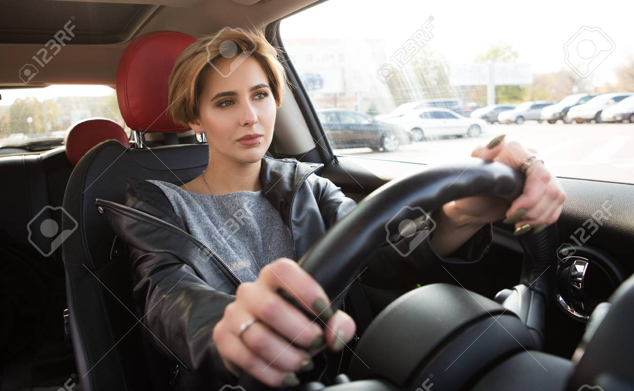 Beautiful Casual Girl Drive A Car An Looking On The Road Safe