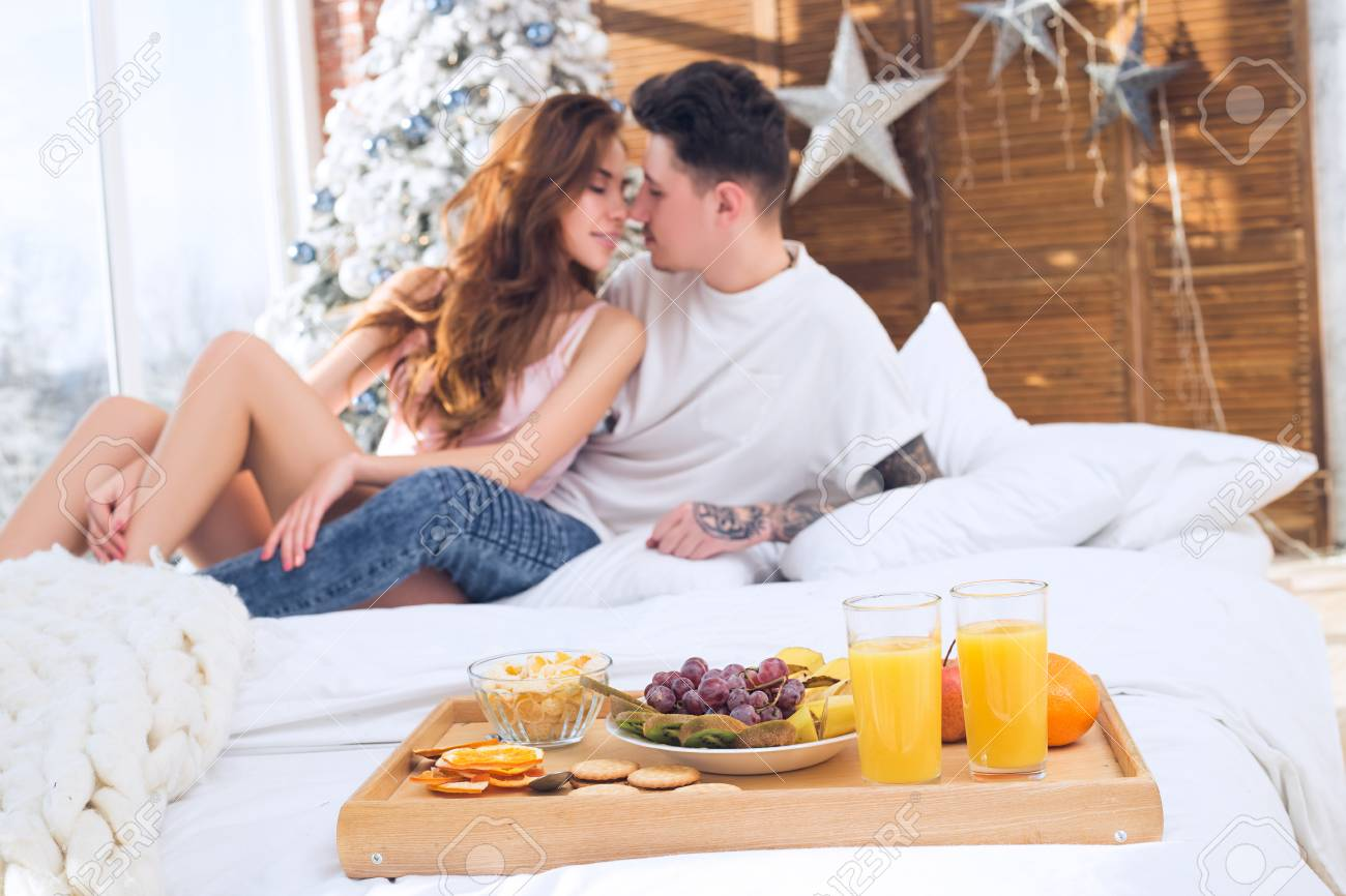 Beautiful Romantic Couple. Healthy Breakfast In Bed. Couple ...