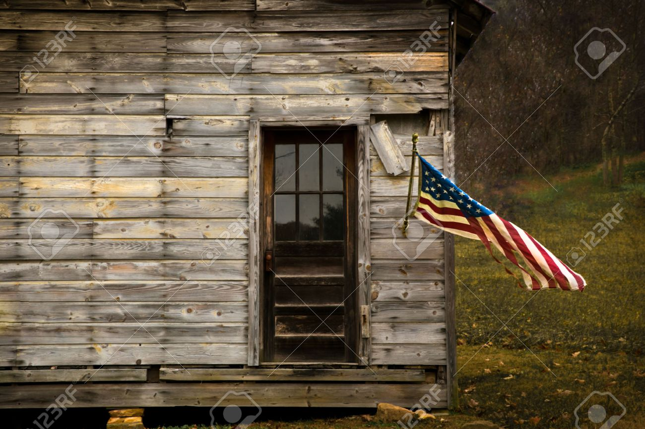 American Flag Hanging From An Old Barn With Negative Space To Display Text Stock Photo