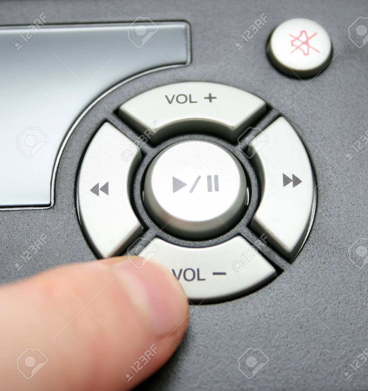 finger turning volume down, focus on buttons Stock Photo - 490306