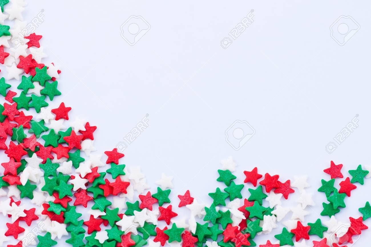 Frame made of small colored stars on the white background Stock Photo - 16933643